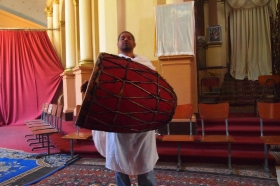 our guide demonstrates chanting and playing the drum